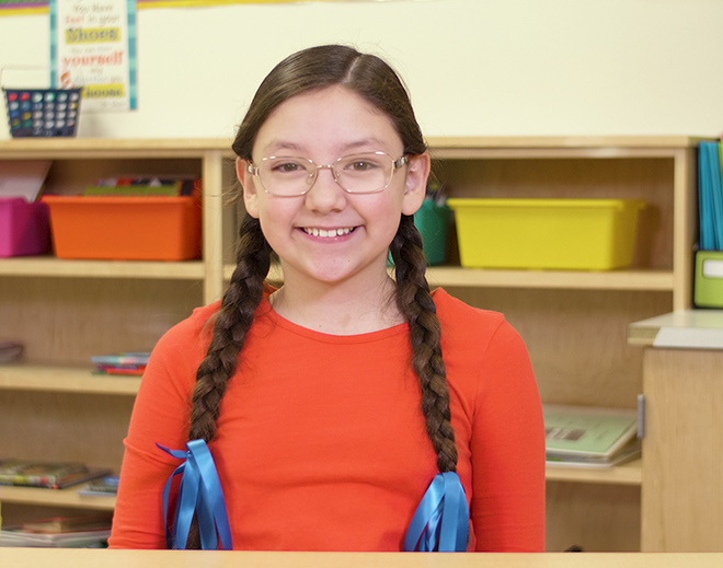 Victoria's glasses helped her in school